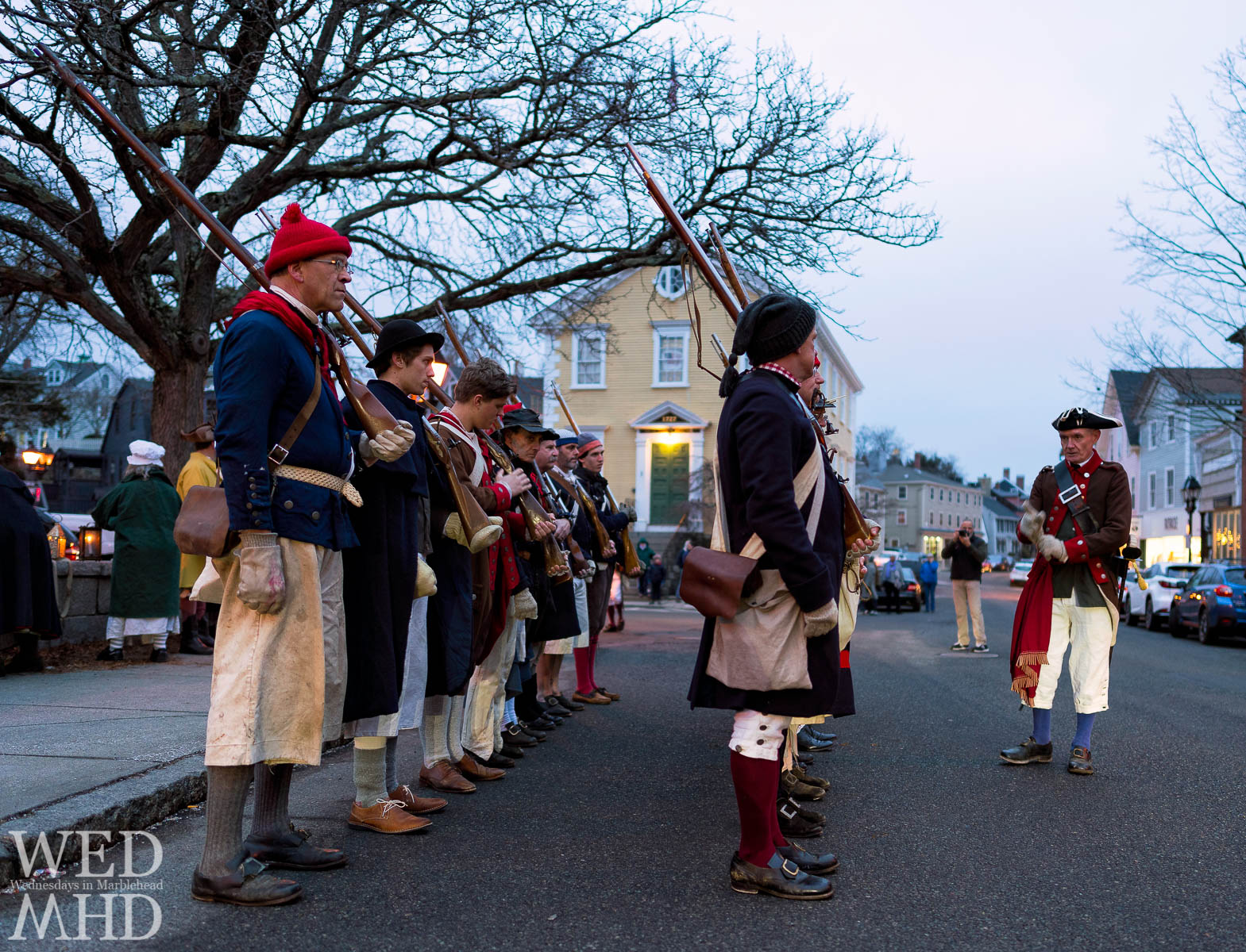 Glover's regiment stands approximately two feet apart while gathered in front of Old Town House before their annual march to Old Burial Hill