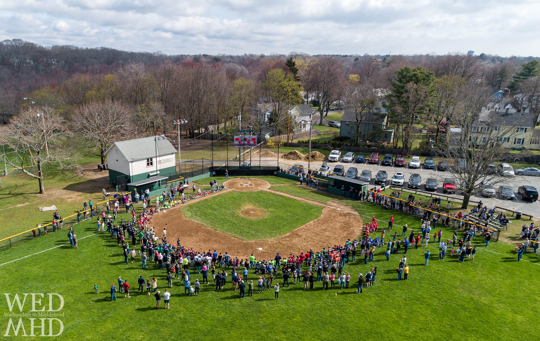 An aerial view of opening day for baseball in Marblehead when crowds of kids and parentls could gather at Gatchell park.