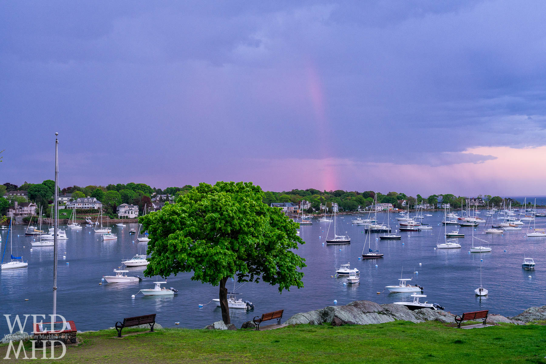 View from Crocker Park at a calm harbor and a rainbow after the storm passes