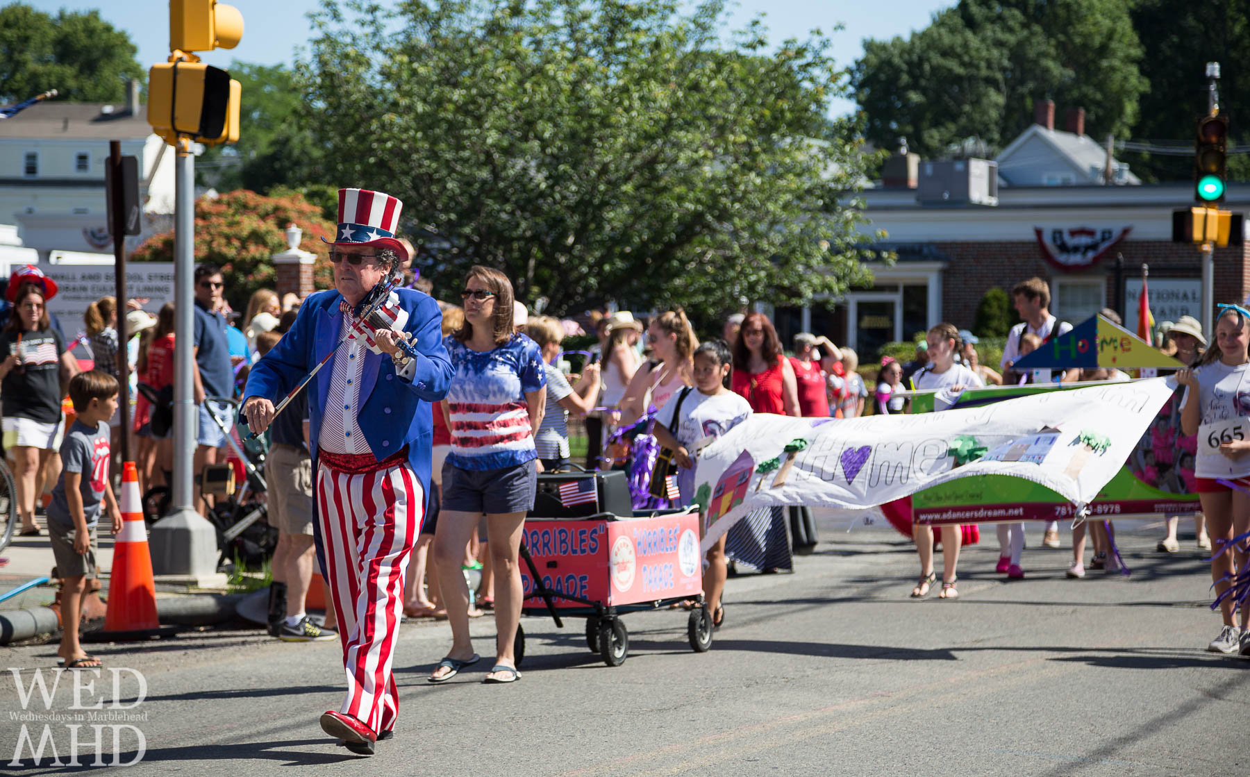 A look back to warm days and crowded streets as the Horribles Parade takes place along Pleasant Street in Marblehead
