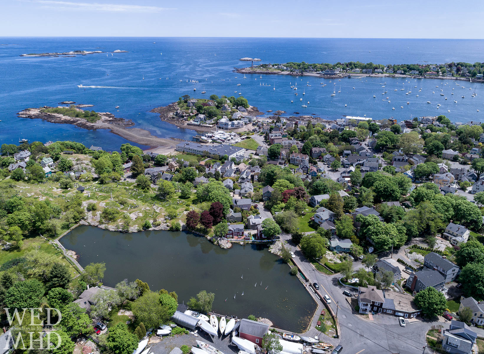 An aerial juxtaposition of big boats in Marblehead Harbor and little boats in Redd's Pond on a May afternoon