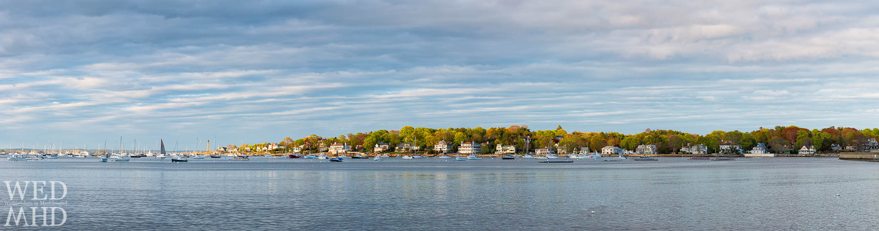 A panoramic view of Marblehead Neck and boats in the harbor from Riverhead Beach