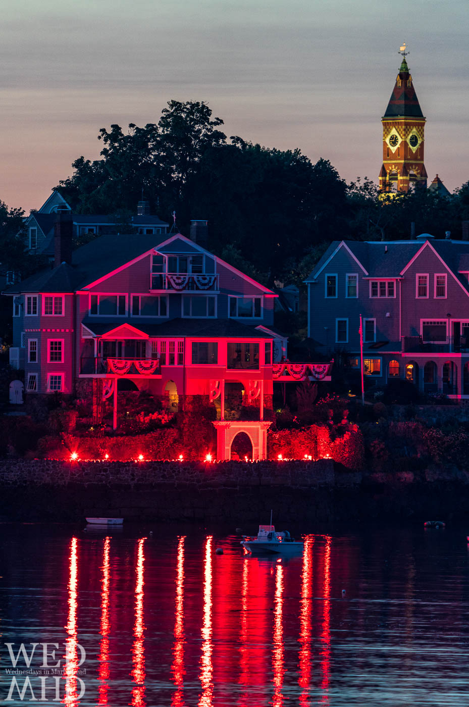 Flare illuminate the whole of Marblehead Harbor on the Fourth of July as in this shot of houses along Cliff Street with Abbot towering over the scene