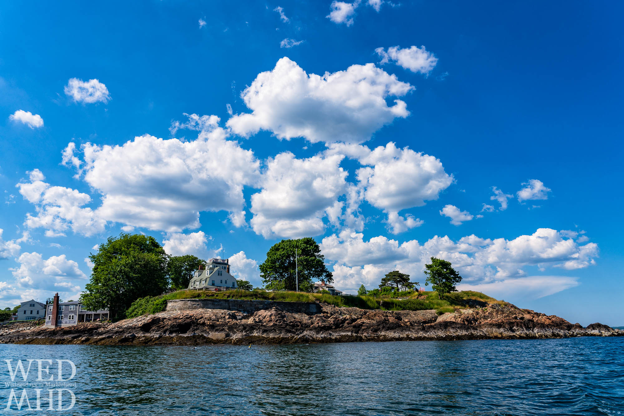 Making our way around the Fort on a warm summer day in Marblehead by way of a dinghy piloted by my daughter. Fort Sewall is undergoing major renovations.