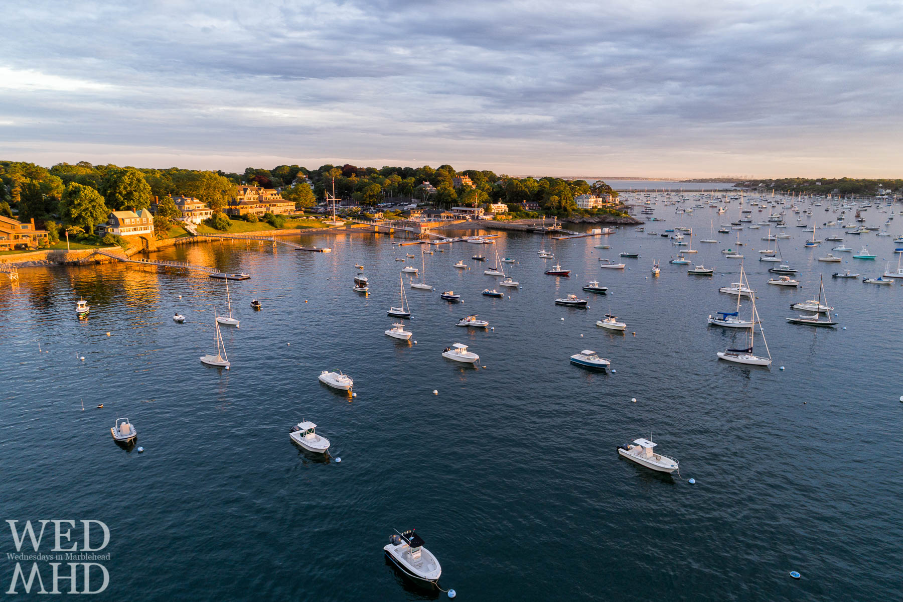An aerial view of boats moored in Marblehead Harbor on a warm June evening seems a perfect image for the weekend