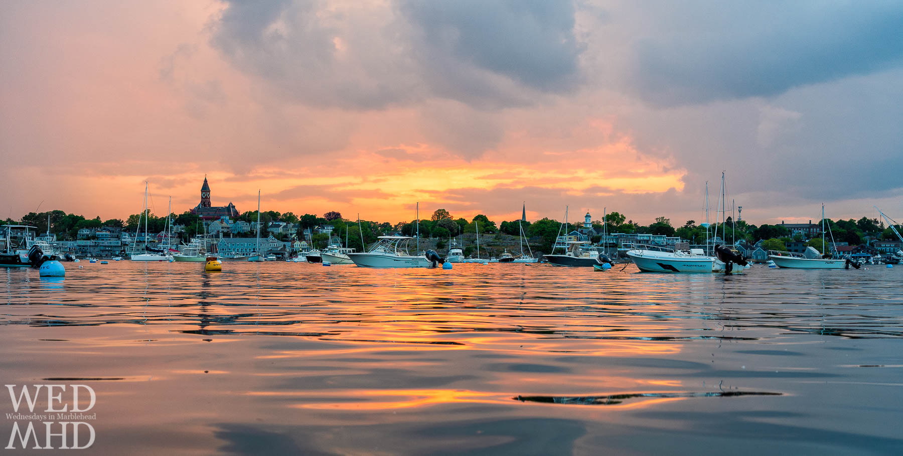Getting low at the waters edge to capture a sunset over the town of Marblehead