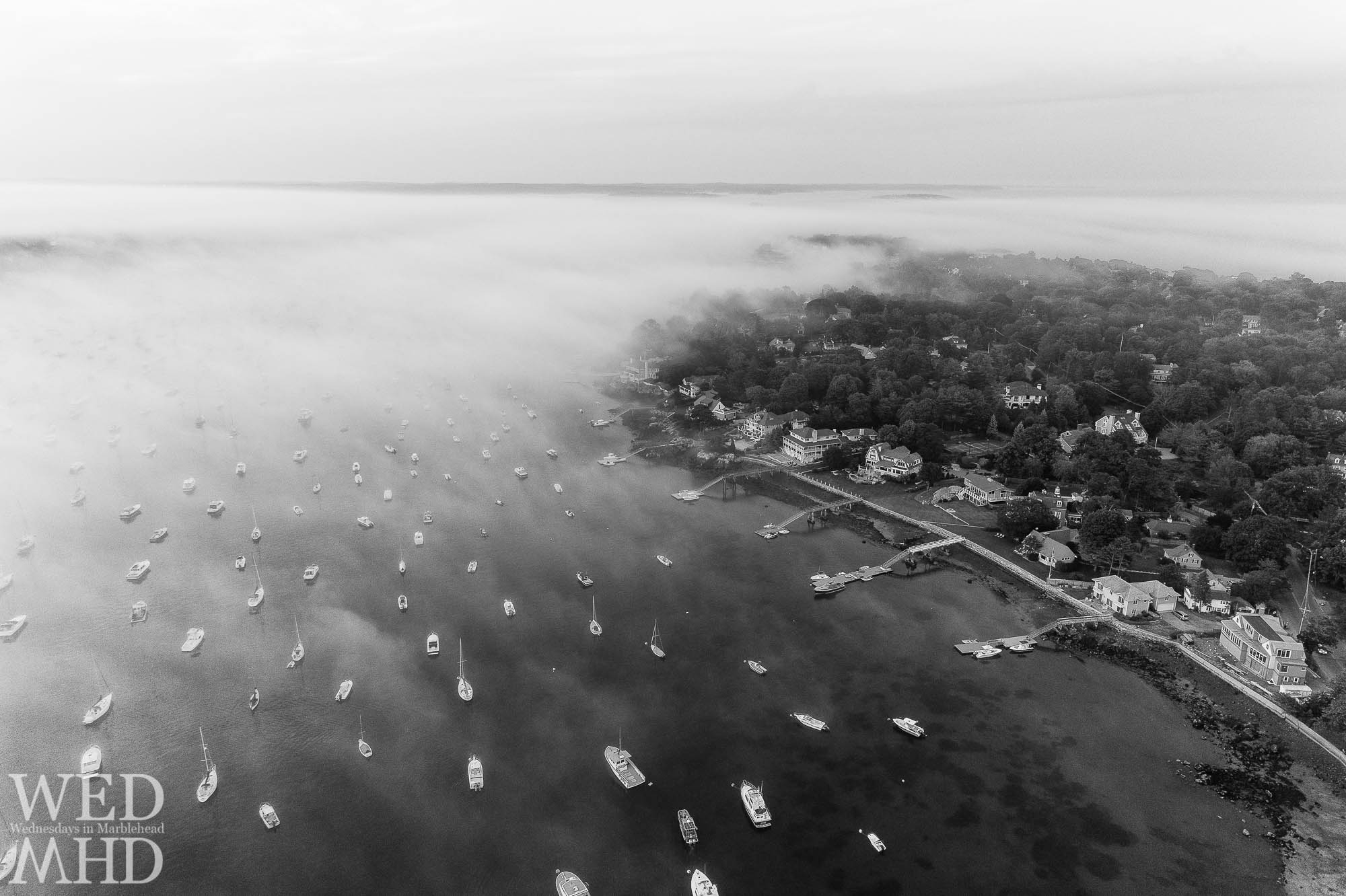 The fog rolls in over Marblehead harbor and the neck in this aerial image captured on a mid July evening