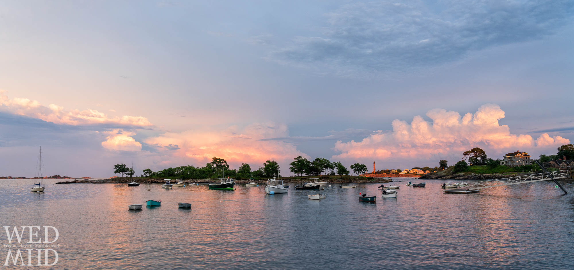 Clouds gather over Little Harbor with sunset bathing them in soft pink light on a calm Summer evening
