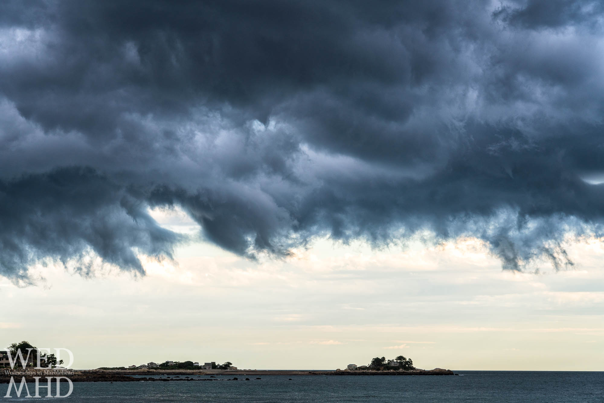 Fractured storm clouds called stratus fractus form over Tinkers Island