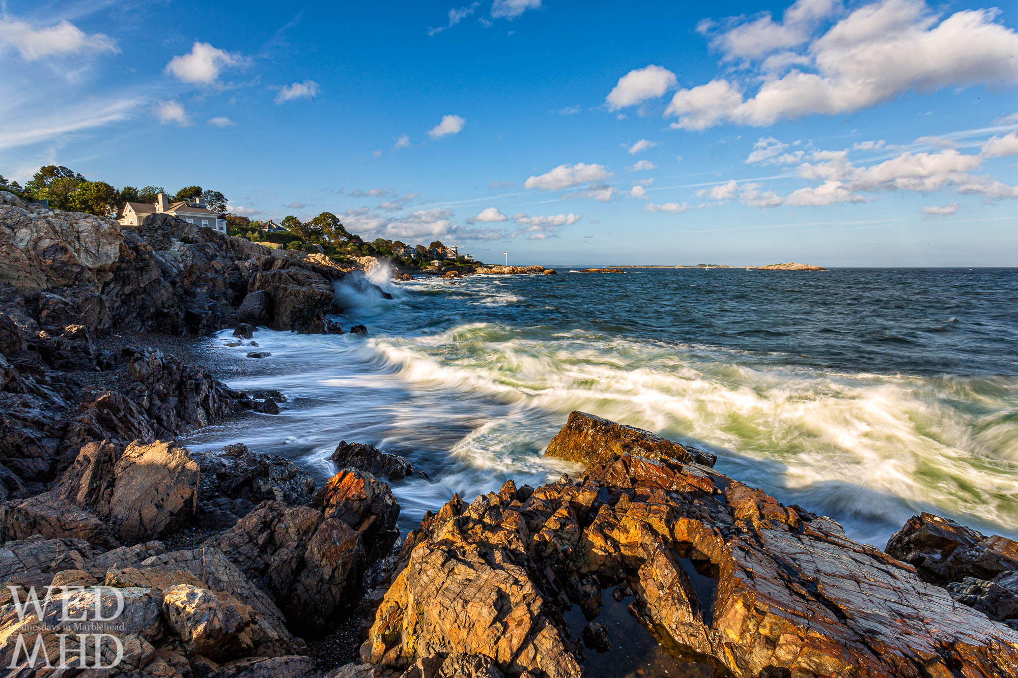 Receding waves form white lines at Castle Rock on a September evening on Marblehead Neck