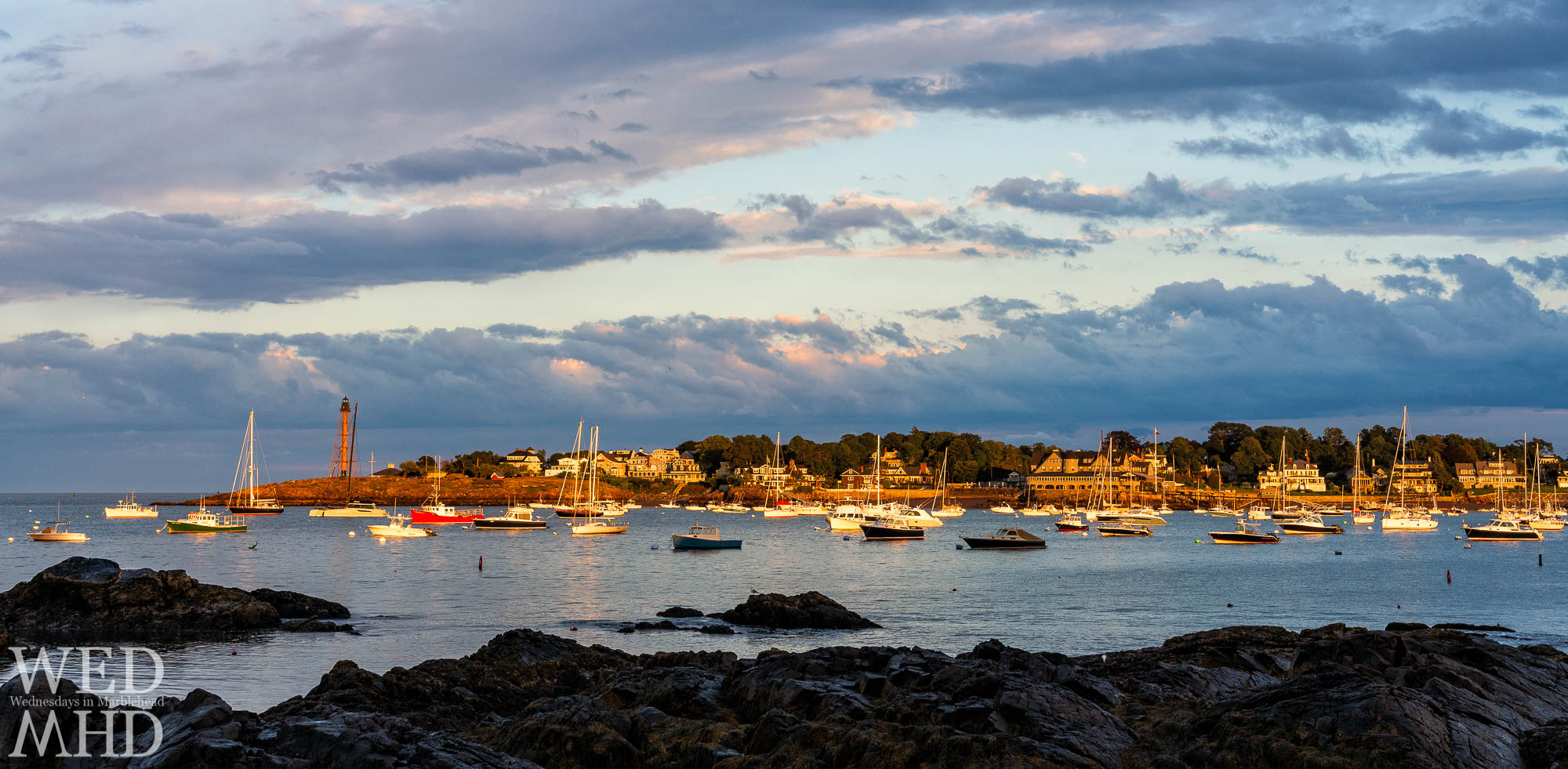 Marblehead Neck and Chandler Hovey Park seen bathing in light of a setting sun after storms pass over town on a mid-August evening