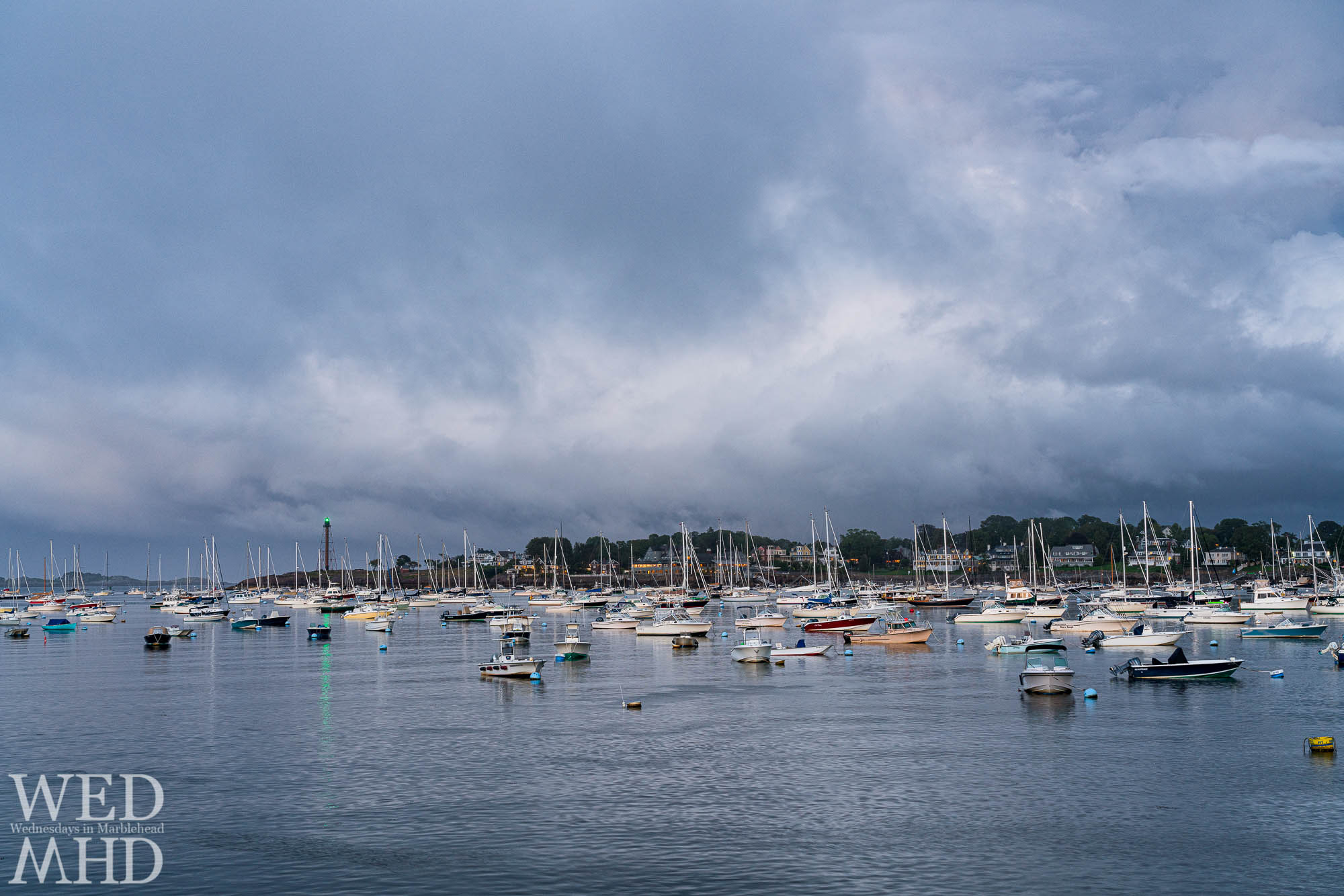Marblehead Light's green light shines during the blue hour in this early September image of the harbor