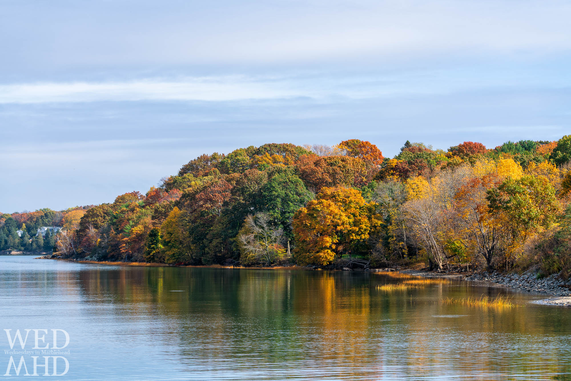 Leaves change at Lead Mills and the colors of fall reflect in the water of Salem Harbor on a late October morning