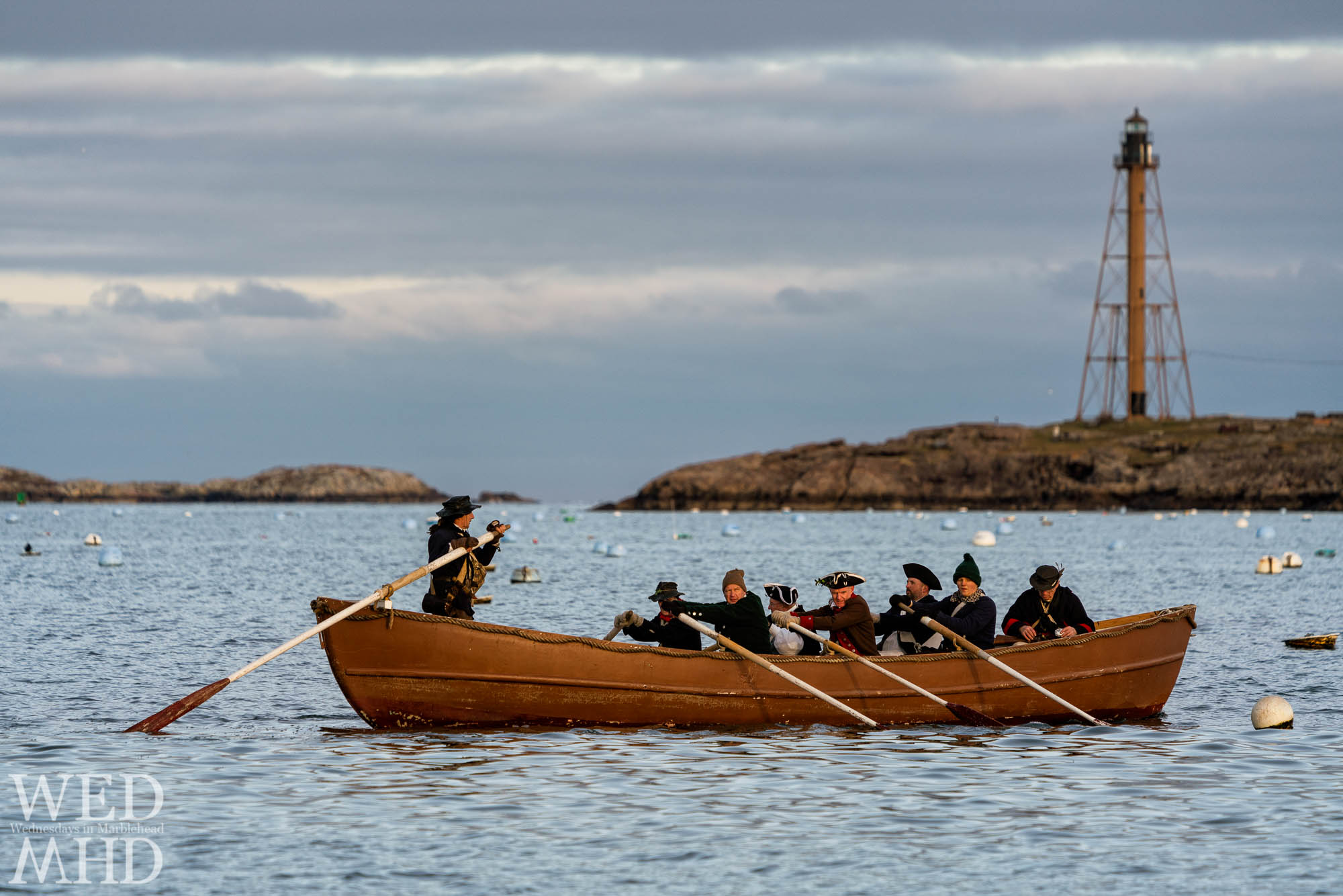 Glover's Regiment recalls simpler days by rowing across an empty harbor in the time before masks and social distancing