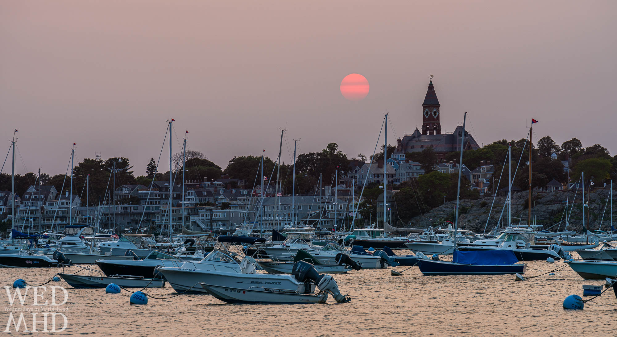 Haze created by fires on the west coast makes for perfect conditions to capture a smoky sunset over Marblehead Harbor on a September evening