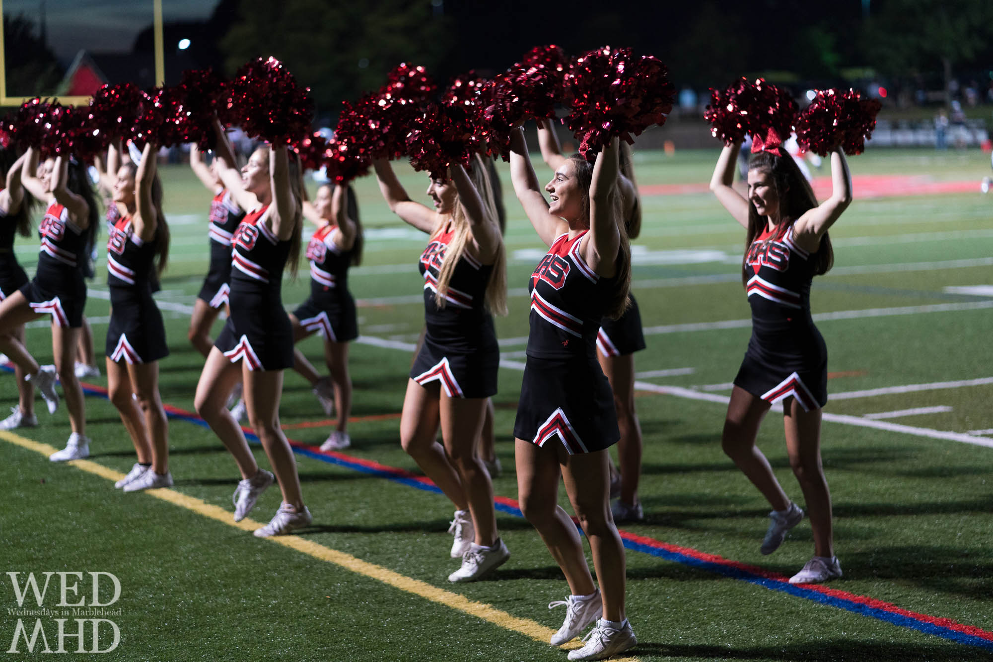 Cheerleaders captured under the Friday night lights in a time before concerns about the novel coronavirus