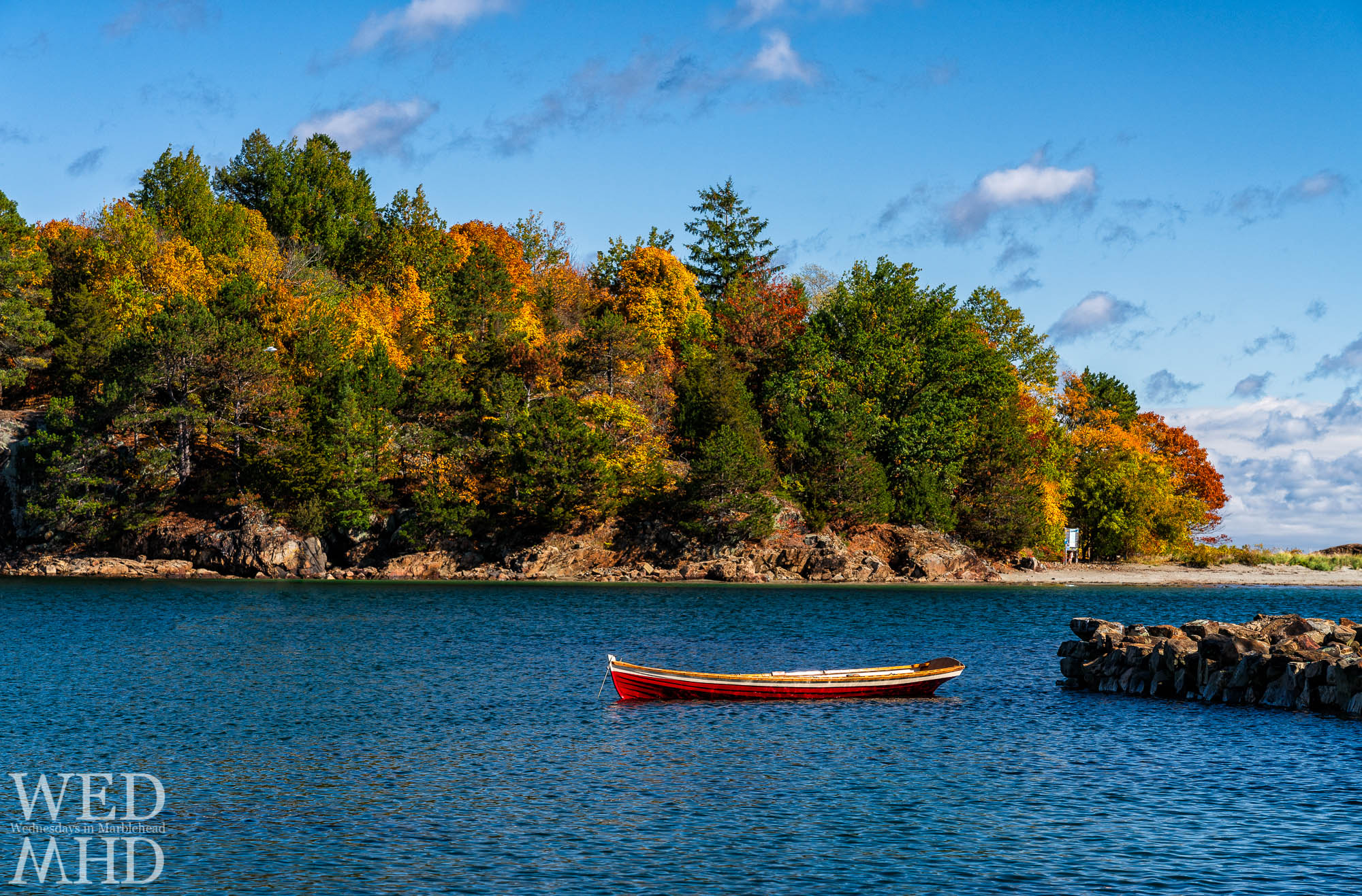 Peak color arrives on Brown's Island with a red skiff floating in the waters of Little Harbor near the high tide mark