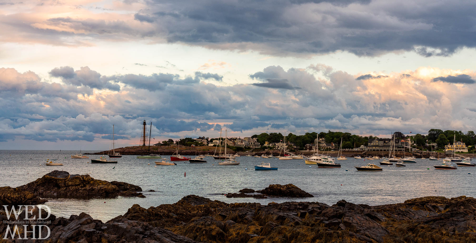 A view of Fort Beach and the Neck after a summer storm passes over Marblehead Harbor creating great cloud cover overhead