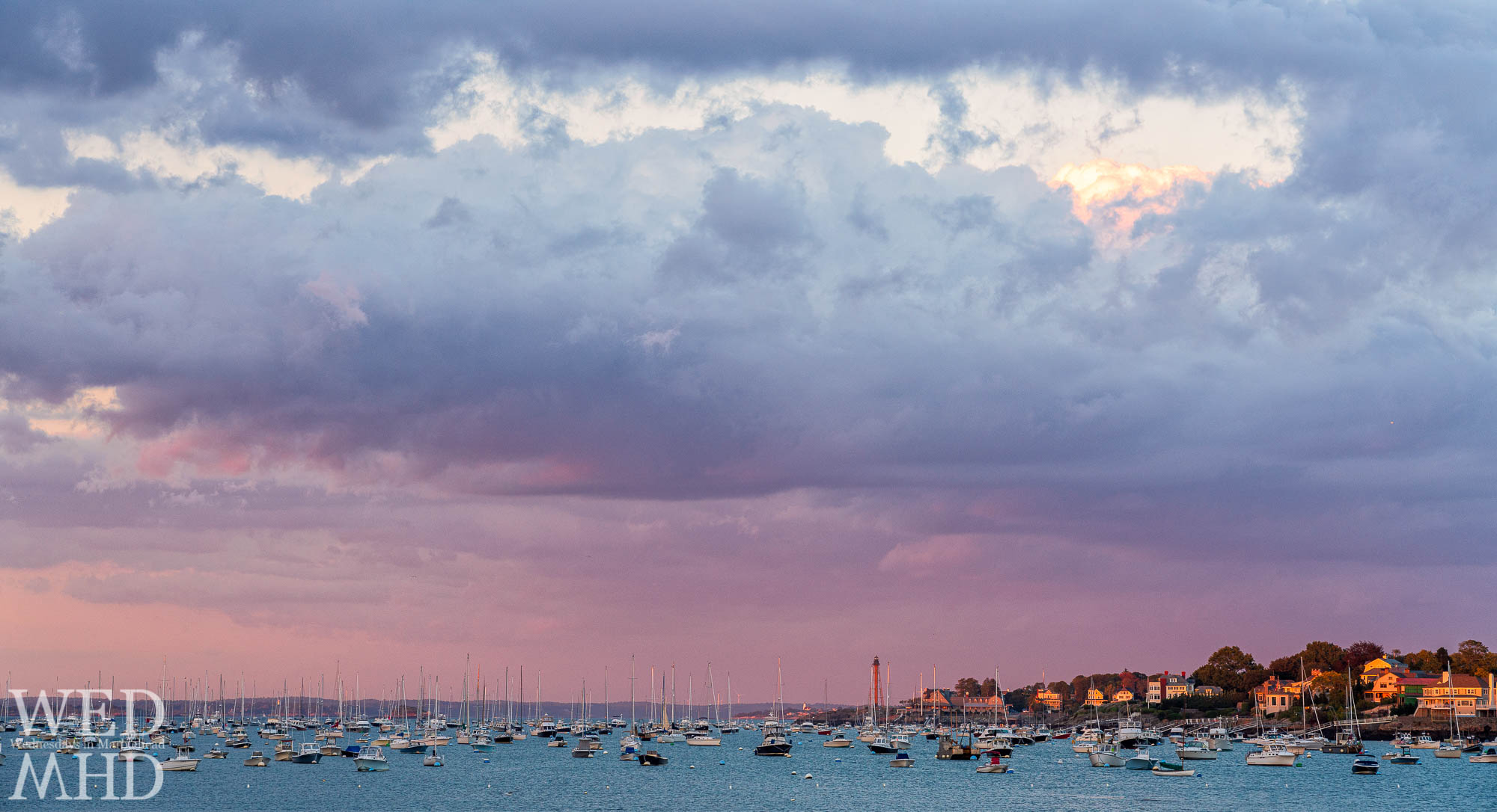 A pink-purple October sky takes shape over Marblehead Harbor as the sun sets on an early October evening