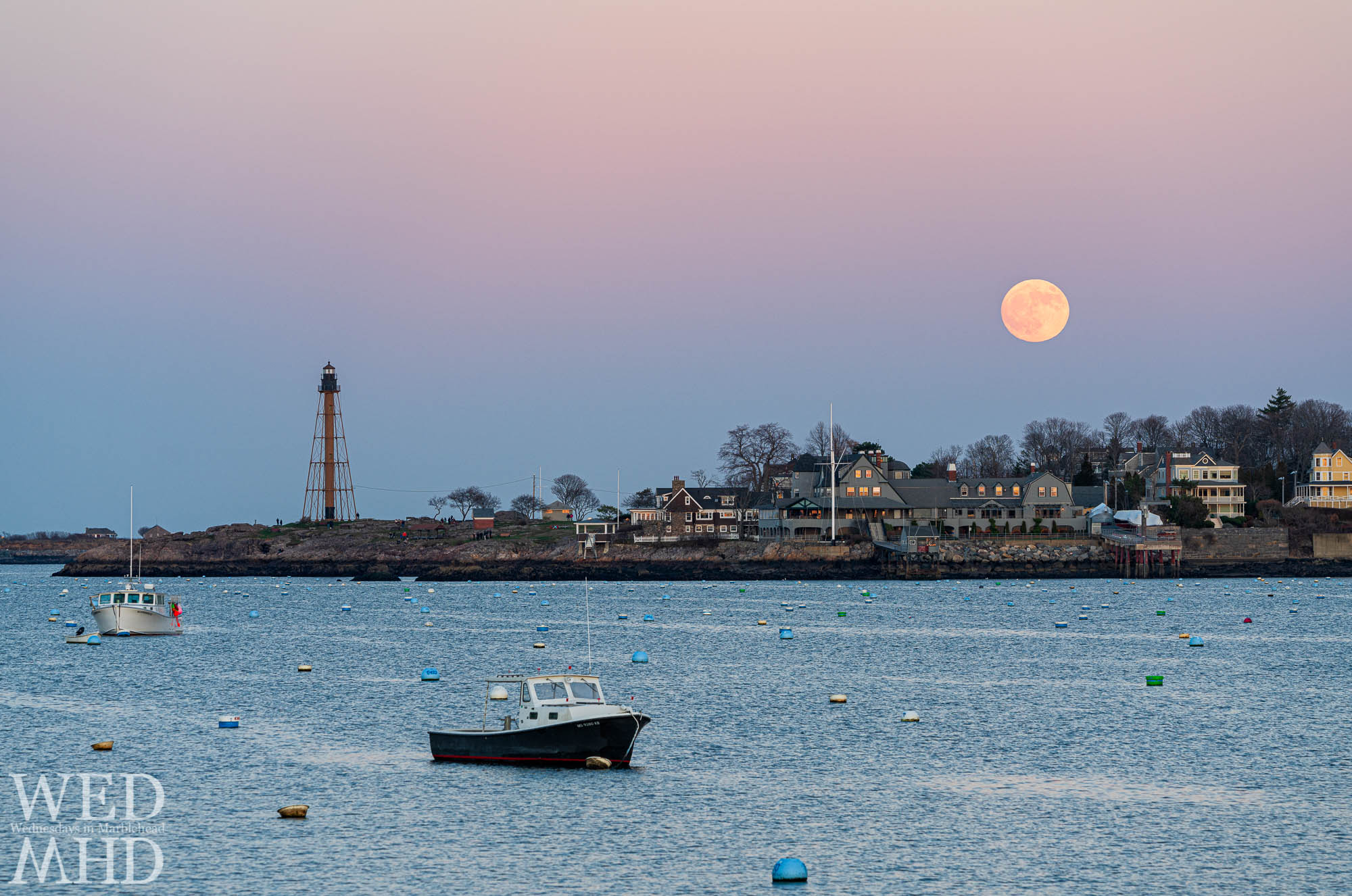 The nearly full beaver moon rises over the Corinthian Yacht Club and an empty Marblehead harbor at the close of the Thanksgiving weekend