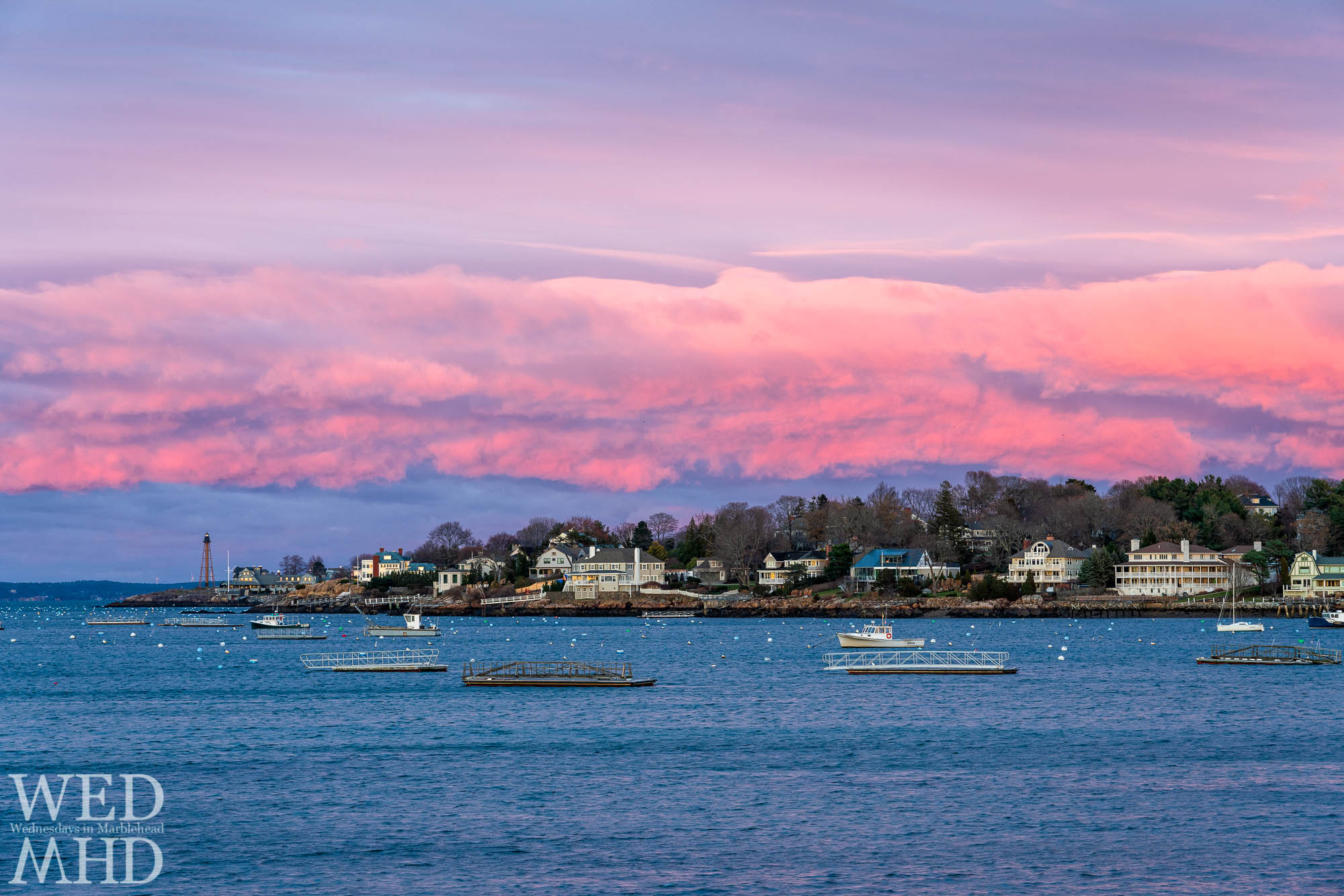A pink layer of clouds creates a perfect Thanksgiving sunset over Marblehead Neck