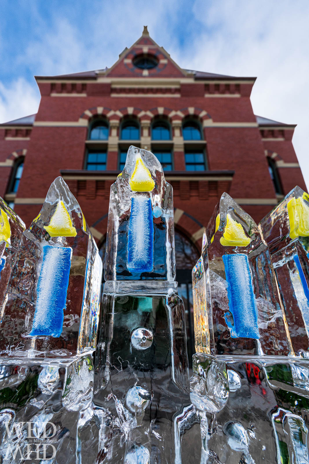 Hanukkah has been called the Festival of Lights and this ice sculpture captures this perfectly with Abbot Hall as backdrop