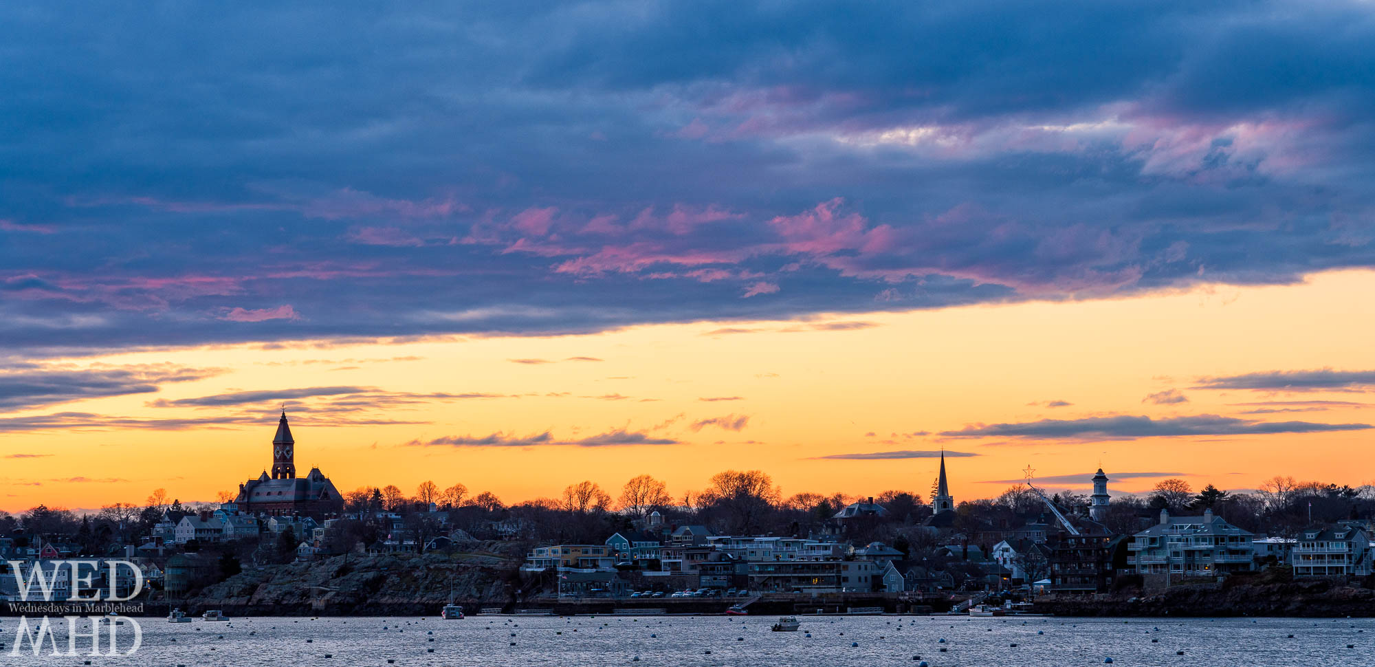 Marblehead's winter skyline features Abbot Hall, St Michael's steeple, the Grace Community Church and a star on the crane over State Street Landing