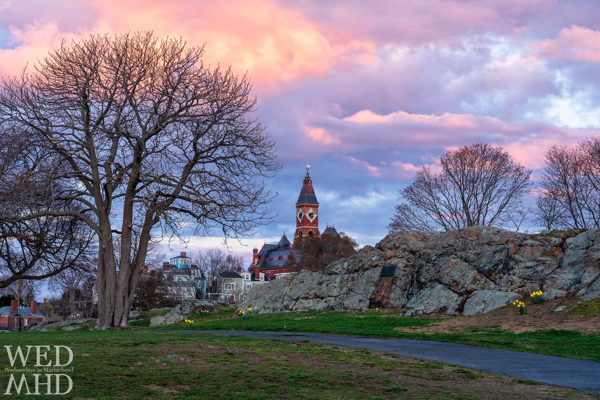 A spring sunrise explodes in color over Abbot Hall as the first signs of spring show at Crocker Park