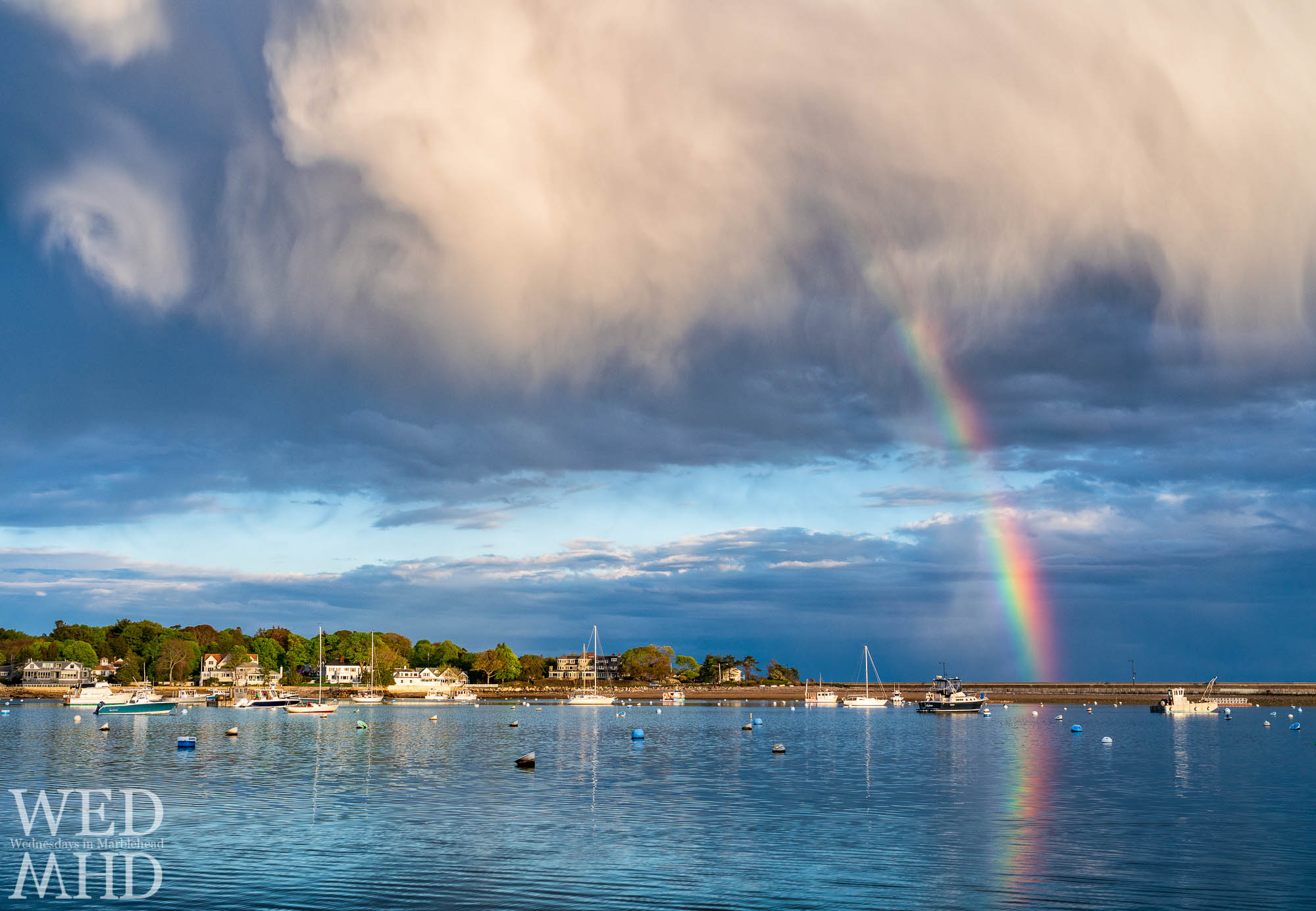 The first rainbow of the season makes an appearance over Marblehead Neck and the causeway after a brief shower