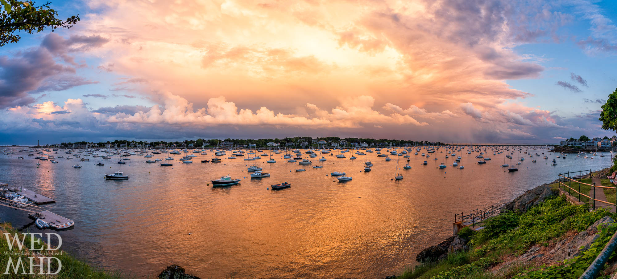 Golden sunset light erupts over Marblehead Neck in this panoramic image captured from the edge of Crocker Park
