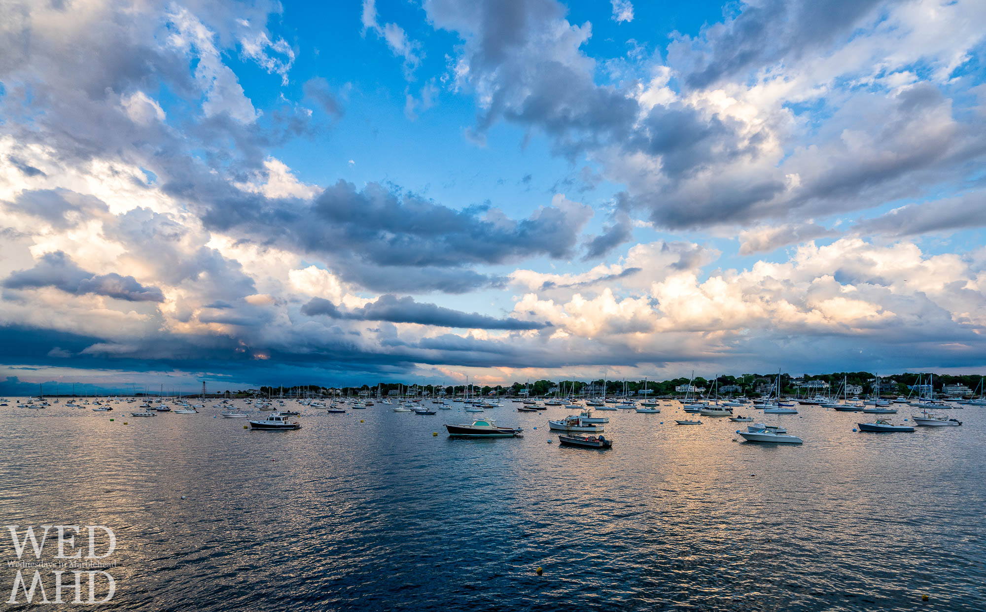 As a sunset takes shape over Marblehead Harbor, I swapped for my widest lens in the hopes of taking it all in