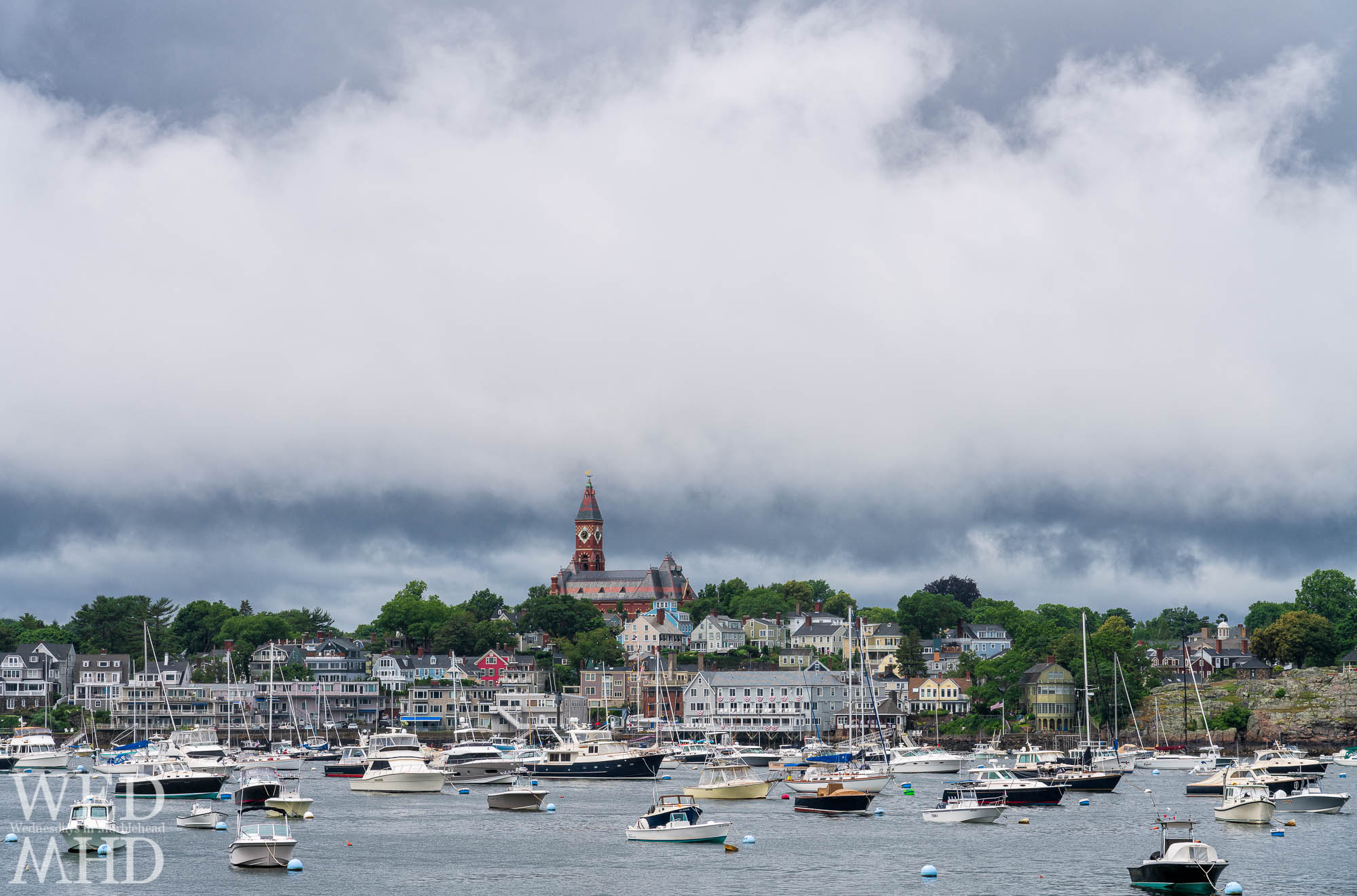 Abbot Hall is seen breaking through the clouds as a low bank hangs over Marblehead on July 4th