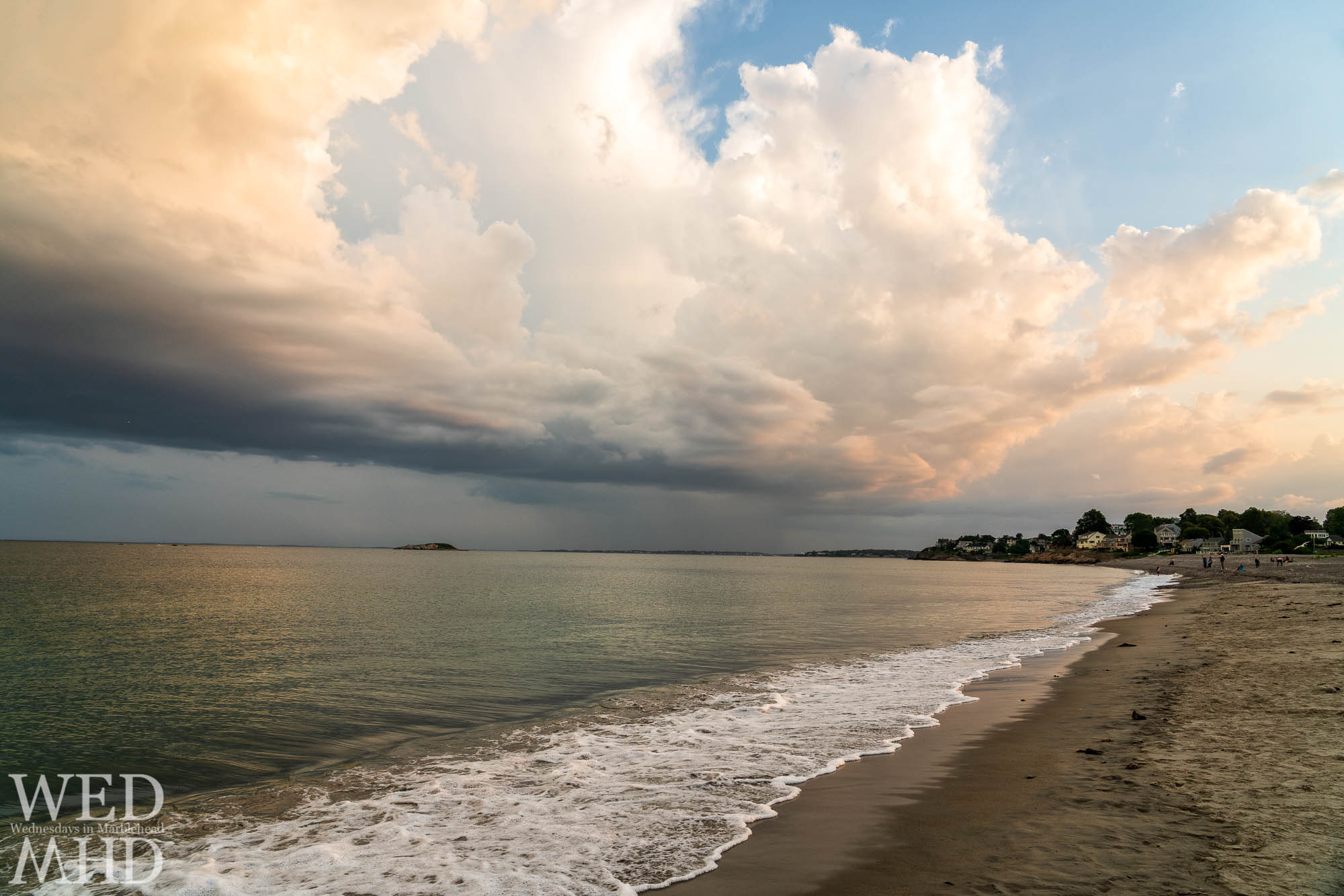 Clouds and surf come together at sunset to create a beatiful scene at Devereux Beach
