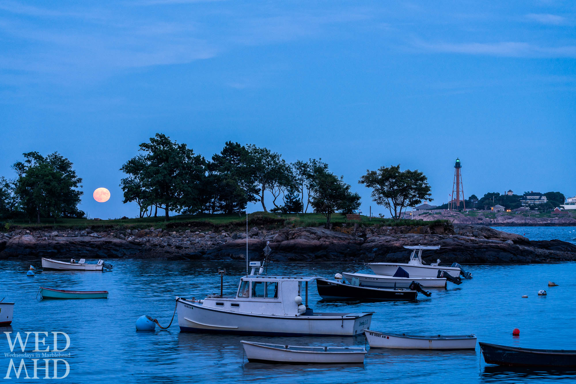 Tonight's blue moon rose against a blue sky over Gerry Island and boats moored in Little Harbor in Marblehead's Barnegat neighborhood