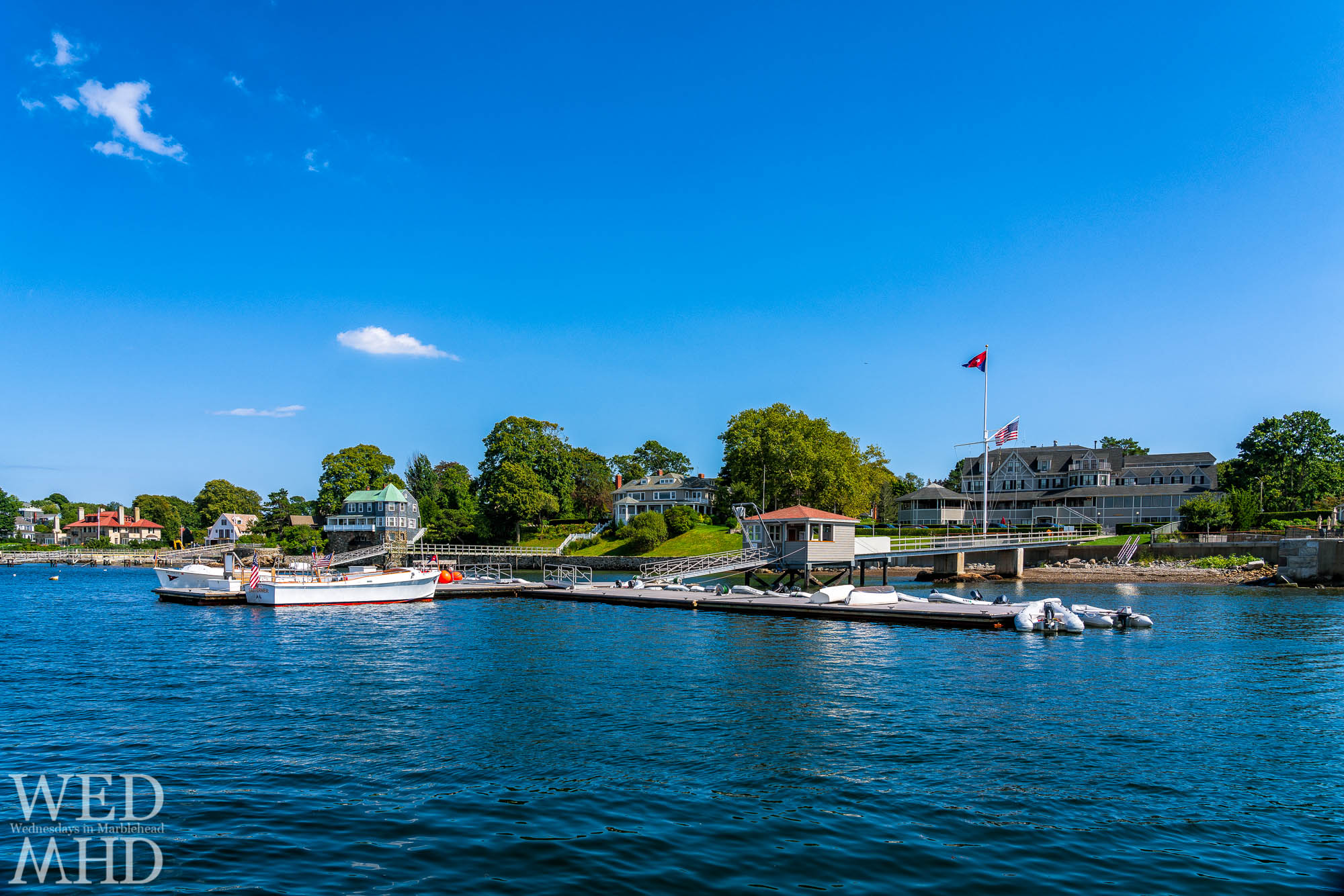Two small clouds fill an otherwise deep blue sky on this bluebird day looking at the whole of the Eastern Yacht Club