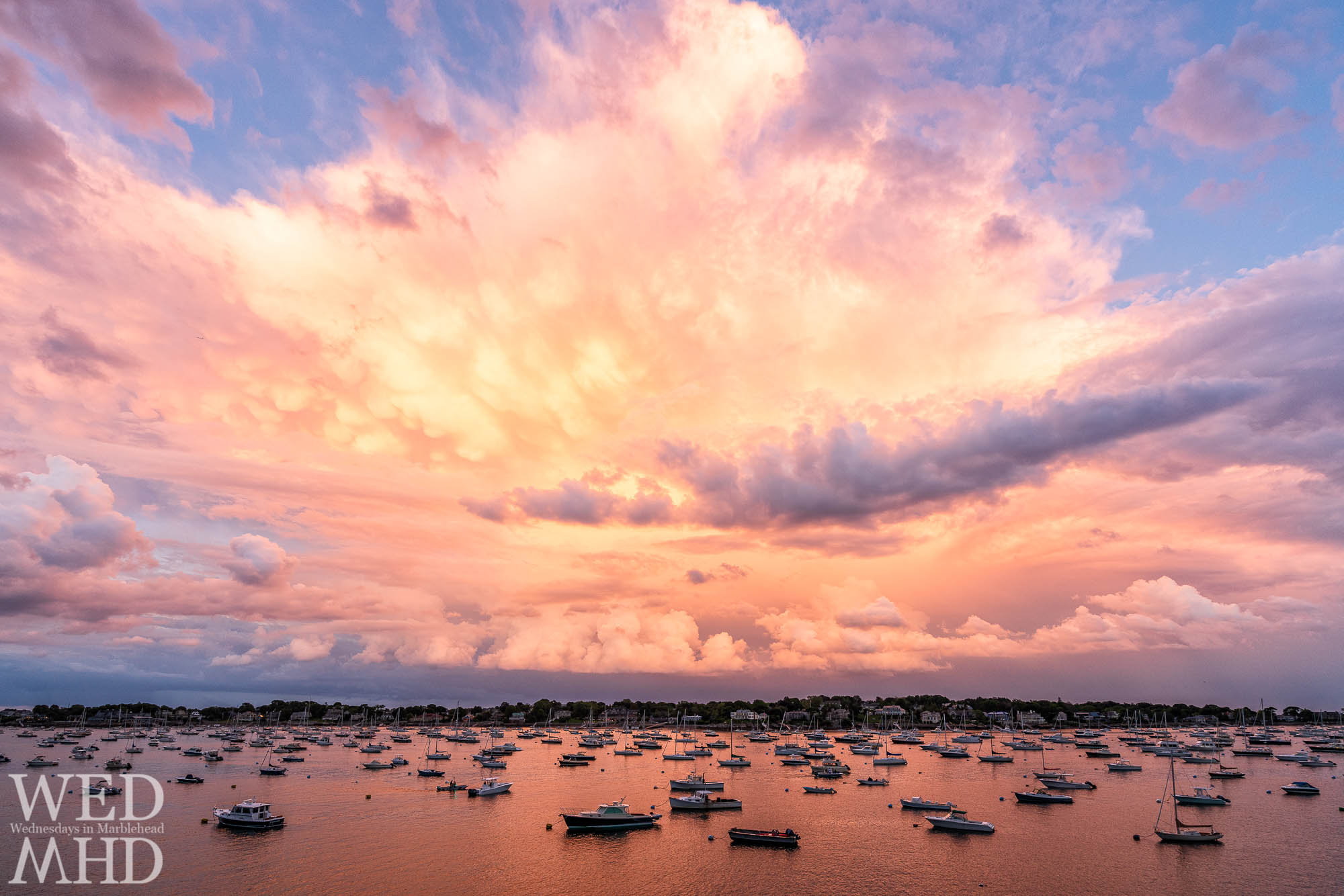 An endless sunset forms over Marblehead Neck on a mid June evening as seen from Crocker Park