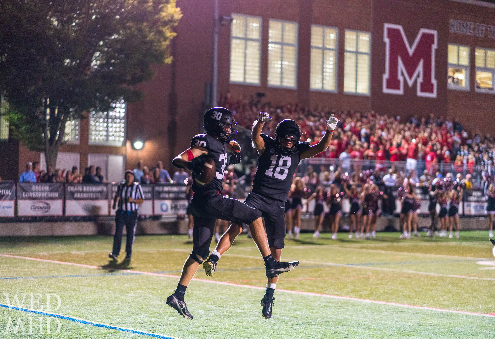 Marblehead's varsity football team takes the field under the Friday night lights with stands filled again
