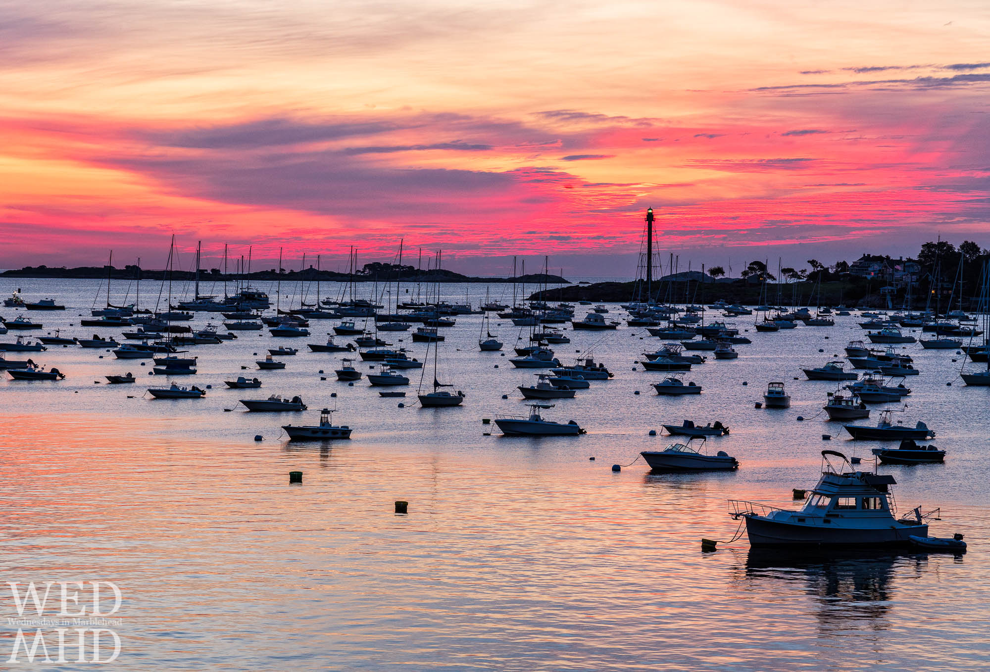 Red sky in morning gives a clue of a storm coming to dump inches of rain on Marblehead