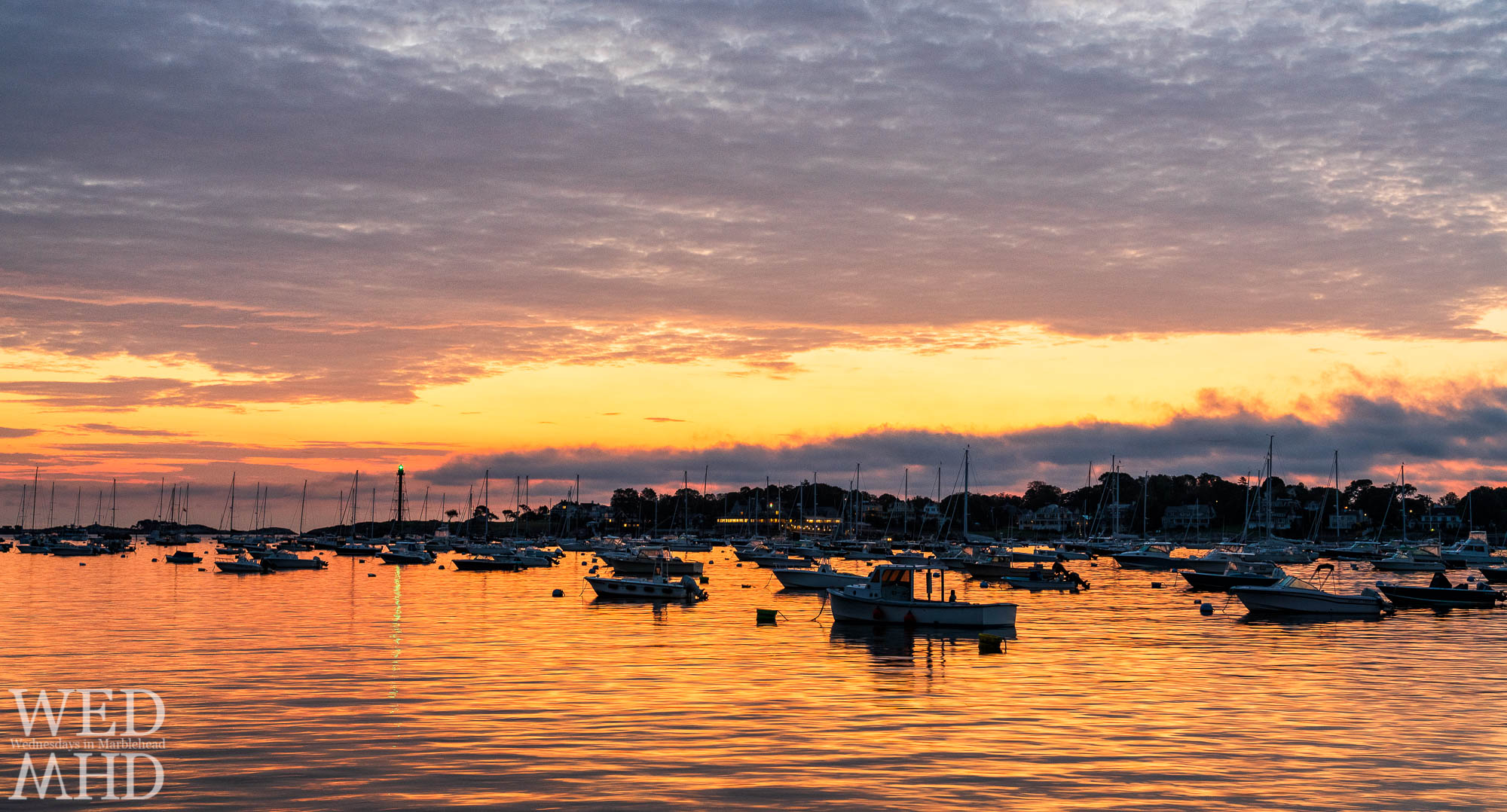 Dawn's early light set Marblehead harbor aglow thirty minutes before the sunrise on an early October morning