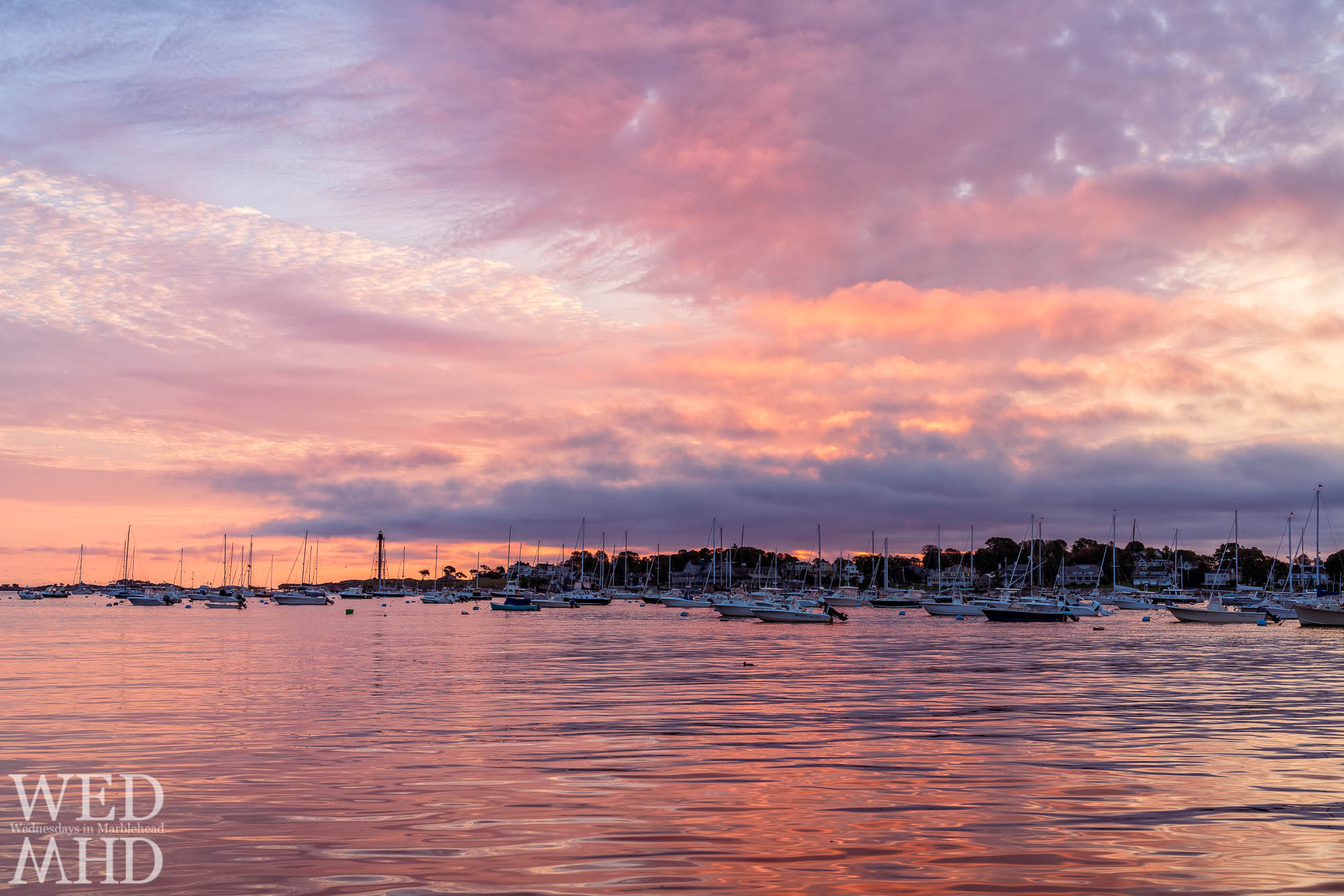 A gameday sunrise forms over Marblehead Harbor still filled with boats on this early October morning with a storm headed our way
