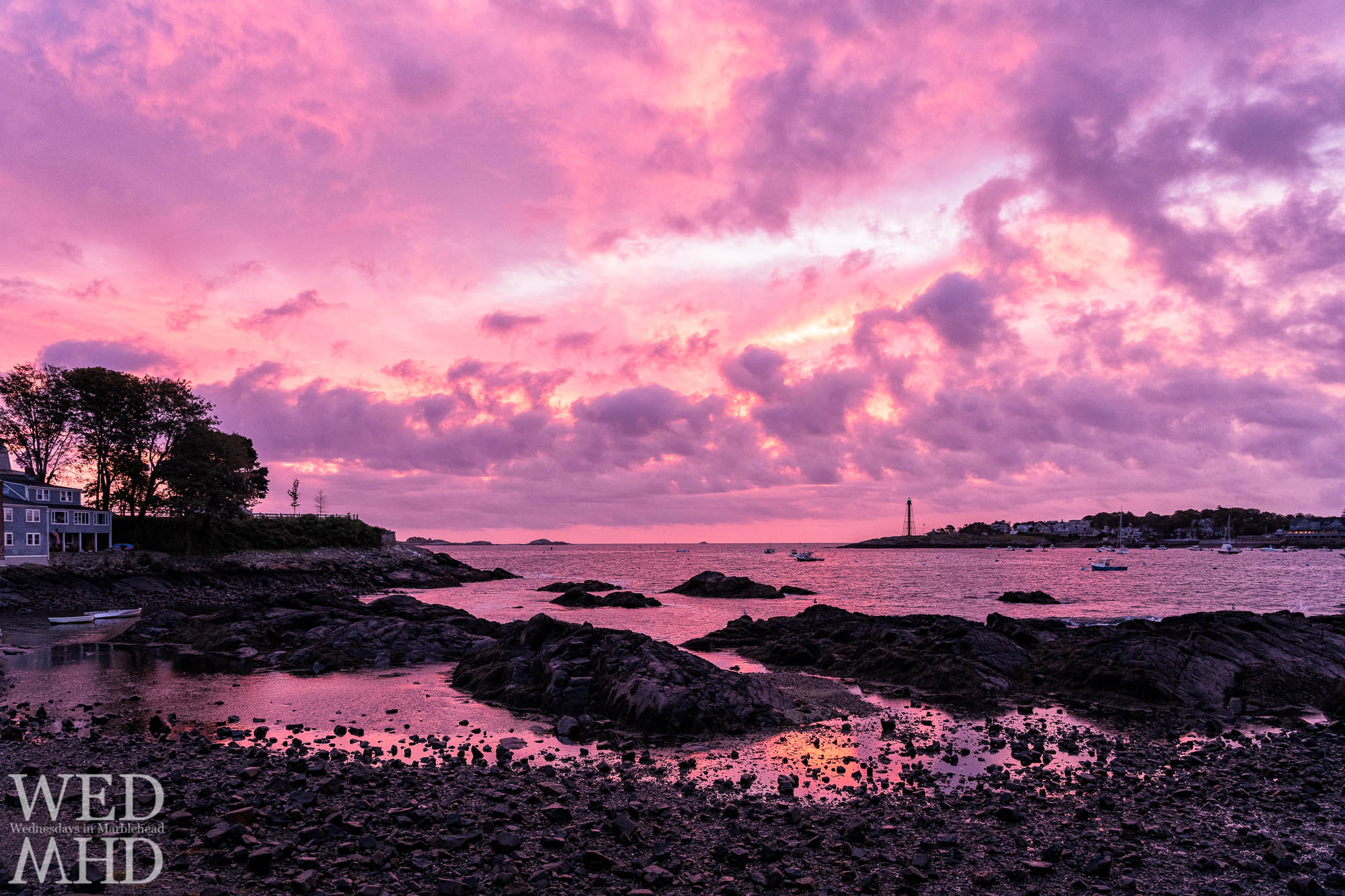 An incredible October dawn takes shape over Fort Beach on a warm Sunday morning in Marblehead. Low tide reflections add to the scene.